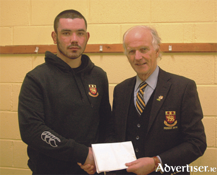 Paul Boyle is presented with the Audi Athlone Man of the Match Award by Buccaneers club