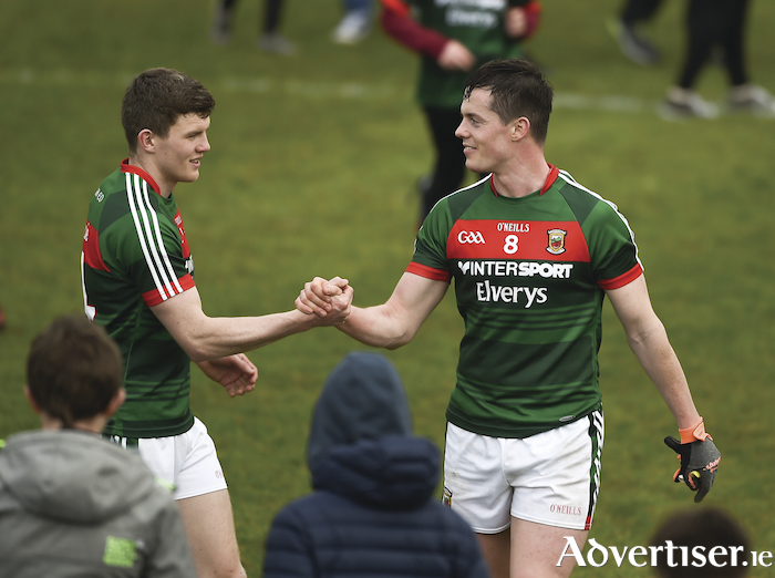 Job done: Eoin O'Donoghue and Stephen Coen celebrate Mayo's win over Kildare last Sunday. Photo: Sportsfile.