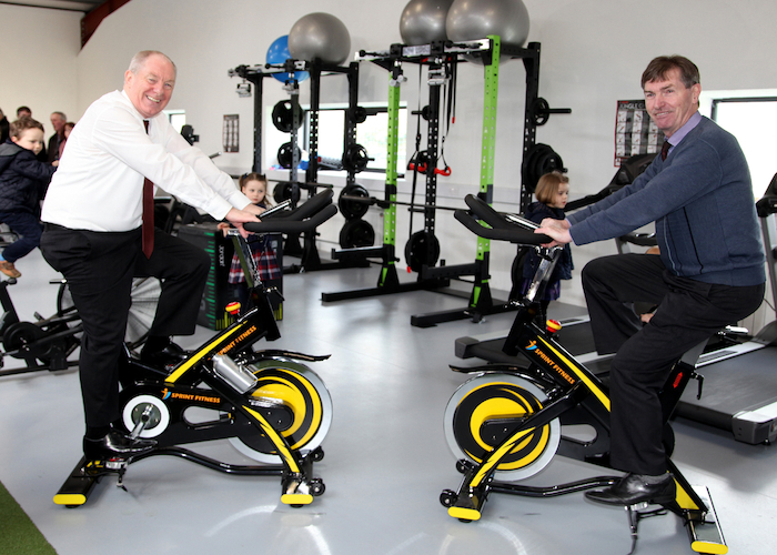 On their bikes: At the official opening of Tourmakeady GAA Club's new facilities were Minister Michael Ring and Cllr Al McDonnell. Photo: Trish Forde.