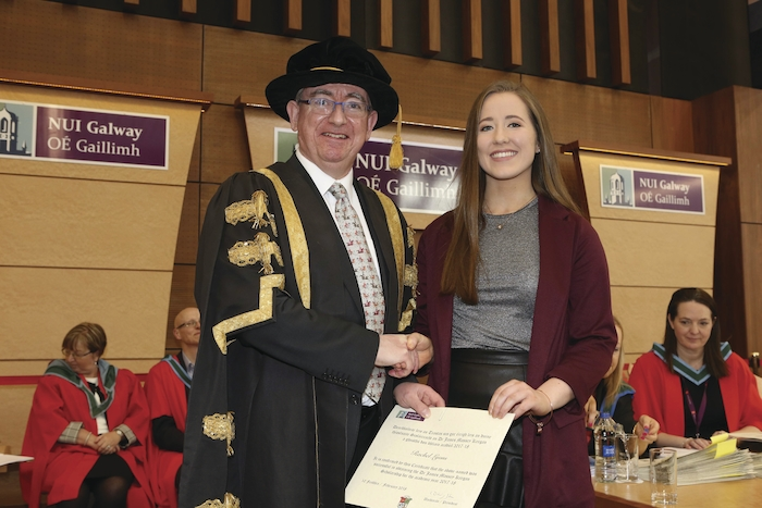 Knock medical student Rachel Lyons has been honoured with the prestigious James Massey Keegan Scholarship from NUIG. She is pictured receiving the award from the president of NUIG Ciarán Ó hÓgartaigh.