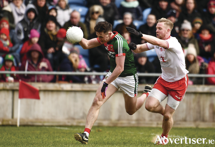 Looking for a break: Diarmuid O'Connor looks to make a break for Mayo. Photo: Sportsfile