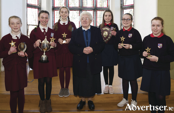 Winners Ailbha Barrett (Capt), Abigail Dolphin and Emily Henehan, from St Ita's  NS with Sr Delourdes  Ciara Tuohy (Captain) with Clare Kennedy and Alenah Keohane from Lisheenkyle NS runners up in the Sr Lourdes debating final at the Aula in NUI Galway