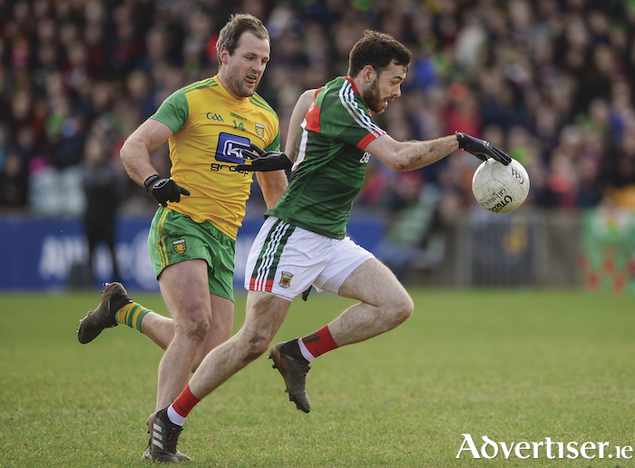 Moving man: Kevin McLoughlin drives forward for Mayo. Photo: Sportsfile