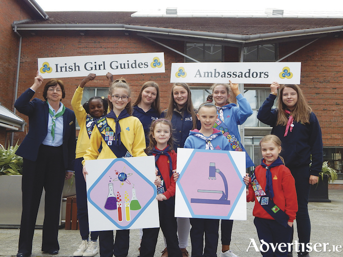 Members of Irish Girl Guides from Doughiska, Galway, pictured with BT Young Scientist prize-winners and award-winning entrepreneurs Kate and Annie Madden who are Irish Girl Guides' new honorary ambassadors. Back row from left: Irish Girl Guides president Maureen Murphy, Megan Emihan (9), Annie Madden (16), Kate Madden (17), Emily Lyons (13), Chloe Conboy (18). Front row from left: Rachel Lyons (10), Ella Power (6), Zoe Power (10), and Sinéad Sweeney (6).
