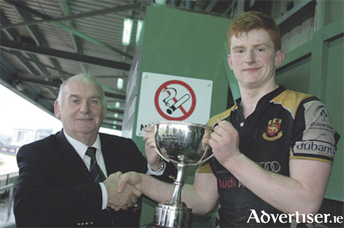 Victorious Buccaneers captain Fergus Galvin is presented with the Connacht U-18.5 Cup by Mossy Moran.