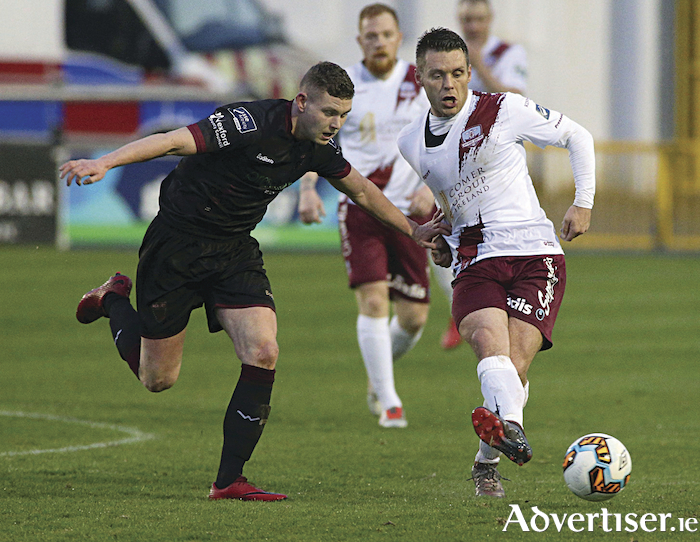 Galway United's Alan Murphy on attack is chased by Mark Slater of Wexford FC in the  SSE Airtricity League game at Eamonn Deacy