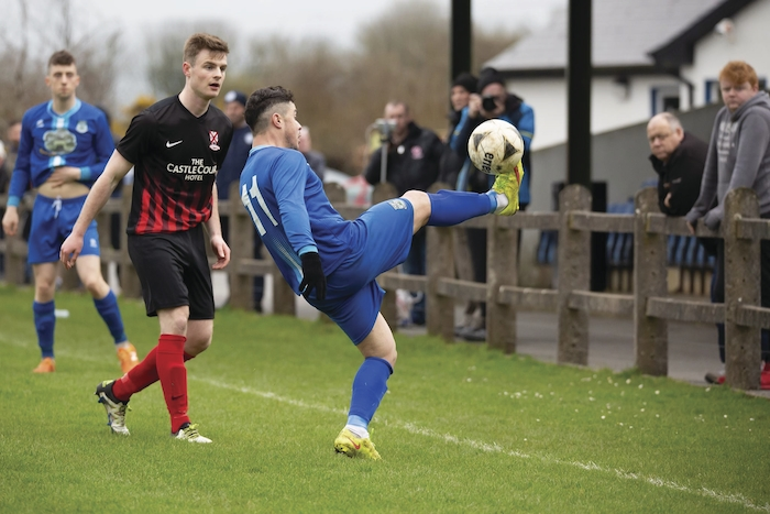 On the line: Manulla's Lucas De Paula looks to keep the ball in play against Westport last weekend. Photo: Manulla FC.