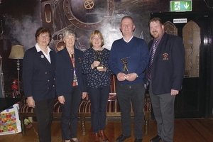 The top lady scorer in the Balla Winter League, Breege Jennings, and the top gents' scorer, James Waldron, at Balla Golf Club - with club officers, Julie Loftus, Carmel Henry, and Paul Murtagh.