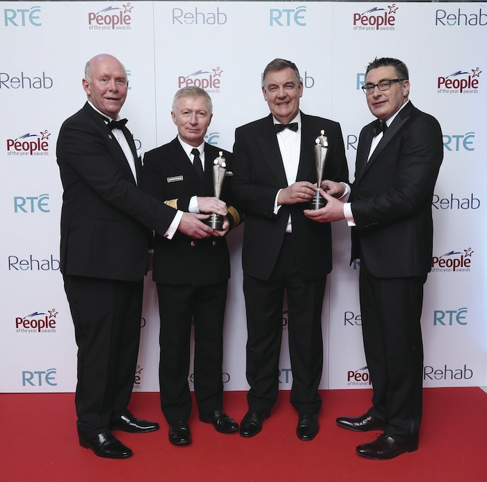 Broadcaster Bryan Dobson (second from right) presents (left to right) John Gallagher, representing the Erris community, Chris Reynolds, director, Irish Coast Guard, and Dr Keith Swanick, representing the Erris community, with a People of the Year Award.