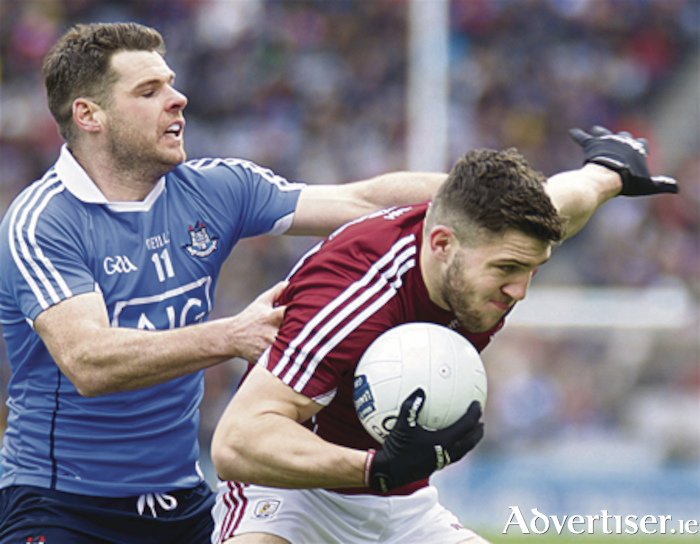 Galway's Damien Comer and Kevin McManamon of Dublin in action from the Allianz Football division one final at Croke Park on Sunday. Photo:-Mike Shaughnessy