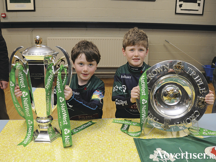 Peter and David Baynes from in Ballina Rugby Club with the Six Nations and Triple Crown trophies. Photo: John O'Grady.