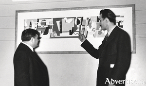 The artist Arshile Gorky having to explain his work to American politician Fiorello La Guardia at the opening of the Federal Art Gallery in 1935.