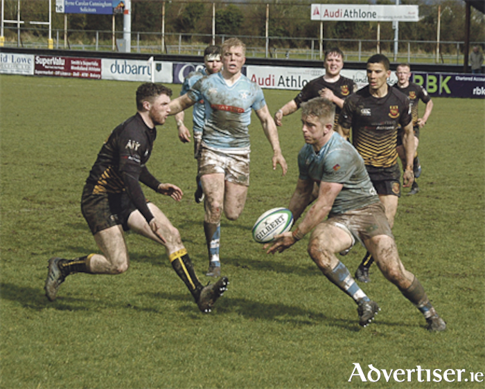 Darragh Corbett preparing to halt the advance of Garryowen's Bryan Fitzgerald