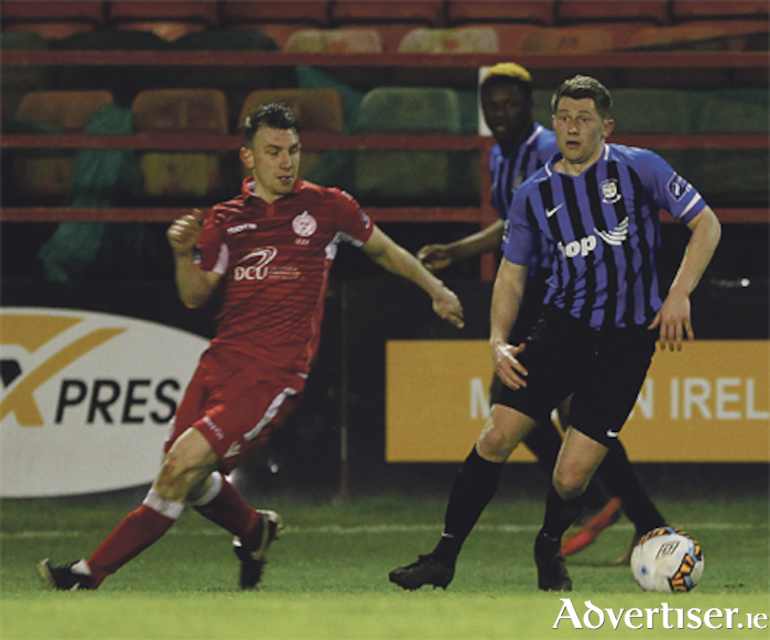 Athlone Town captain Craig Shortt gets away from James O'Brien during Friday's match against Shelbourne in Tolka Park. Photo: Ashley Cahill/AC Sports Images