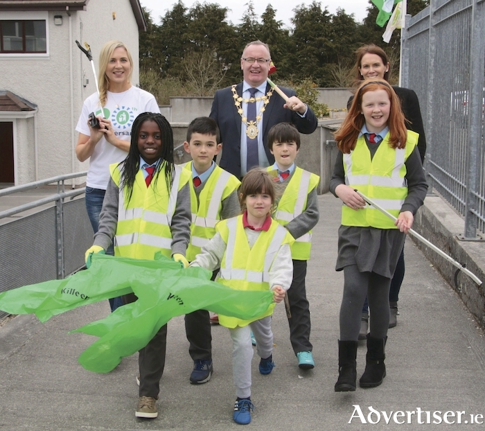 Hi Ho, Hi Ho .... Mayor Pearce Flannery with Sarah McGovern (left) An Taisce, Marise Nic Cumhaill school co-ordinator along with Anita Anna, Tommy Griffin, Maeve Trill and Alice Sweeney pictured at Bushy Park National School on Tuesday for the launch of Galway City Council An Taisce Litter Clean Up, Pic: Mike Shaughnessy