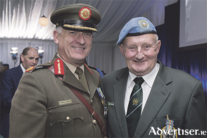 Brigadier General Peter O'Halloran, Assistant Chief of Staff, with John Gorman at the medal ceremony in Custume Barracks last year