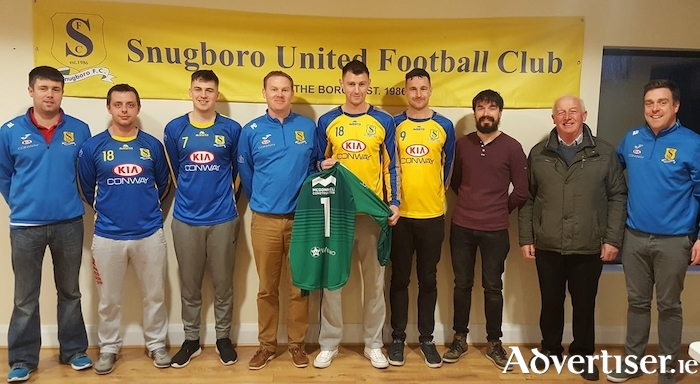Conway Motors, Castlebar, presenting two new sets of jerseys to Snugboro United.