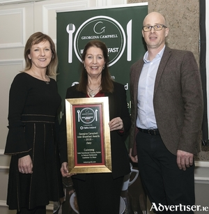 Georgina Campbell (centre) presenting the Dairy award to Breda Butler of Cuinneog, with Breda's husband Colm Carney, at the Irish Breakfast Awards.