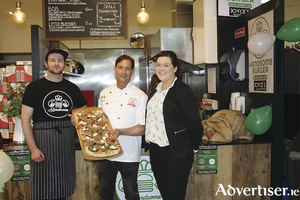 From left: Callan Qualter from Handsome Burger, Matteo Magnetti from Pizza M, who is just back from the Pizza World Championships in Parma, and Louise Kelly from Joyce's Athenry, pictured at the pizza burger party held recently in Joyce's Supermarket, Athenry, to celebrate its new food court.