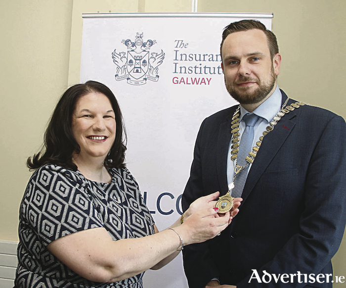 Past president of the Insurance Institute of Galway, Arlene O'Brien, presents the President's chain to John Walsh, who was elected President,  at the Institute's AGM, at the Galway Bay Hotel. John is a Commercial Lines Executive, with Hastings Insurance Brokers and is based out of their Tuam office.