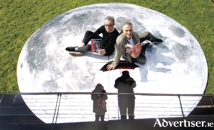 John Crumlish, GIAF CEO; and Paul Fahy, artistic director GIAF; on a cutout of Museum of the Moon, a spectacular giant moon featuring detailed NASA imagery of the lunar surface by UK artist Luke Jerram, who is known worldwide for his large-scale public artworks at the announcement of the programme for the 2018 Galway International Arts Festival Programme on Wednesday. Photo:- Mike Shaughnessy