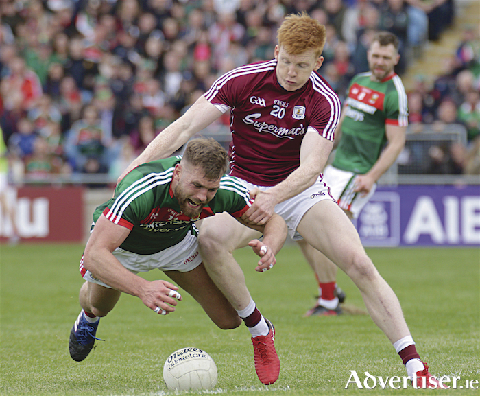 Galway sub Peter Cooke takes on Mayo's Aidan O'Shea in action from the Connacht GAA Football Senior Championship quarter-final at McHale Park, Castlebar, Sunday.