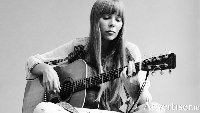Joni Mitchell photographed in 1968 by Jack Robinson.