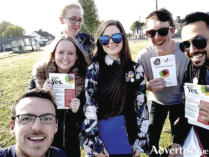 Joe Loughnane (right) and other young men join Galway women to canvass for a Yes vote.