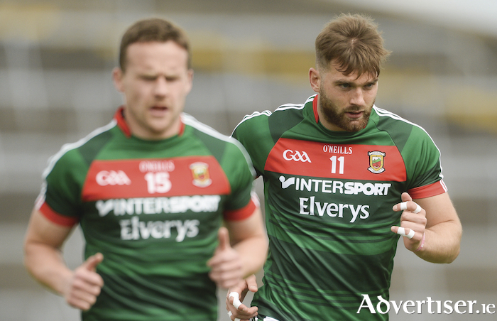 On the road: Andy Moran and Aidan O'Shea take to the field in Limerick last year for Mayo's game against Cork - they will be back in the Gaelic Grounds for the qualifiers. Photo: Sportsfile.