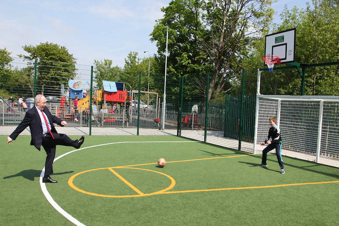 Going for goal: Minister Michael Ring TD shoots for goal against Sean Colgan from Claremorris at the opening of the Claremorris MUGA facility in the town. Photo: Trish Forde.