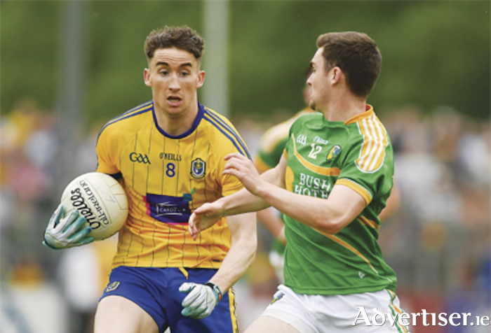 Cathal Compton of Roscommon in action against Ryan O'Rourke of Leitrim. Photo: Piaras O Midheach/Sportsfile
