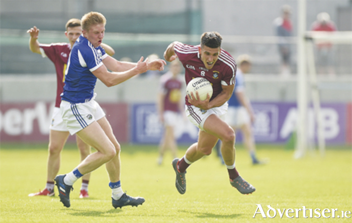 Denis Corroon of Westmeath in action against Alan Farrell in the defeat by Laois. Photo: Sportsfile
