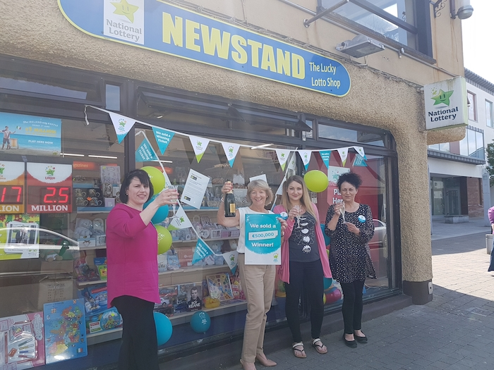 Vivian Barrett, Helen MacHale (Proprietor Newstand), Olwin Goggins, and Mary Lally celebrate the win outside Newstand.