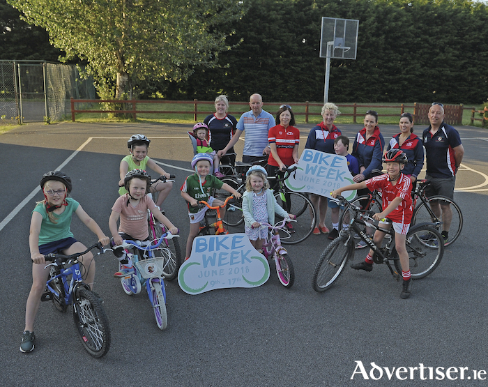 On your bike: Members and friends of Ballintubber Cycling Club pictured at Ballintubber National School with Mayo Sports Partnership representatives ahead of the National Bike Week event that the club will host next week. Photo: Conor McKeown.