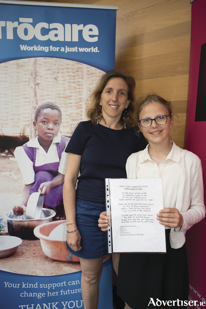 Sybille de Pluvie with her mother and her winning poem