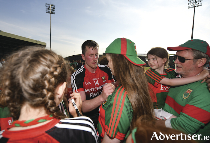 Fans favourite: Cillian O'Connor signs autographs' for supporters after Mayo's win on Saturday. Photo: Sportsfile