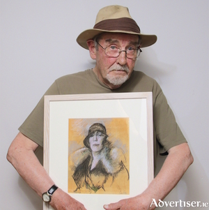 Artist Charles Cullen with his portrait of Nora Barnacle. Photo:- Mike Shaughnessy