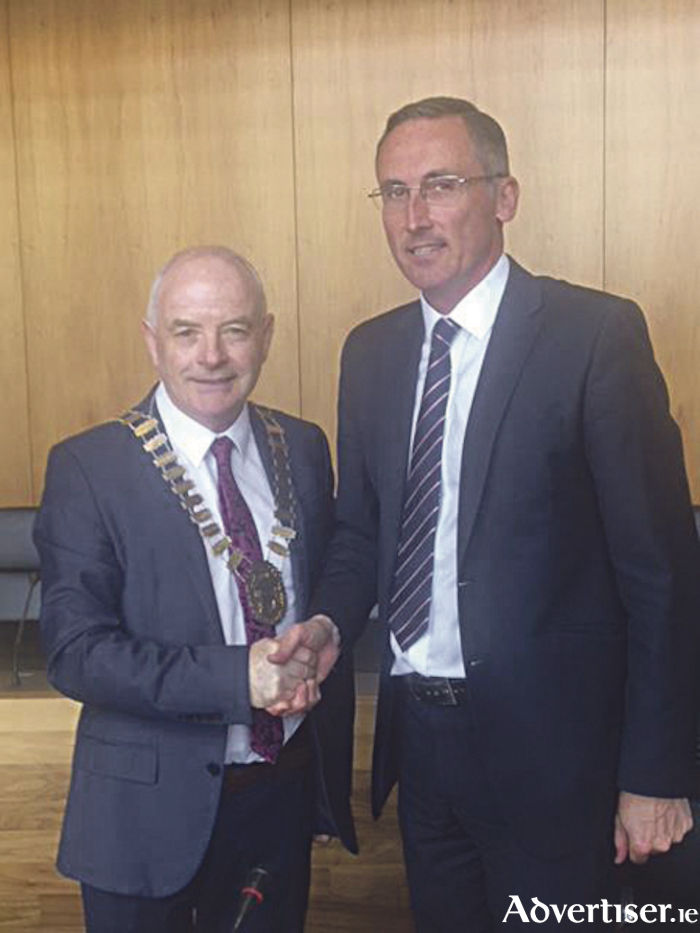 Incoming Mayor of Athlone, Cllr. Frankie Keena receives his chain of office from Cllr. Aengus O'Rourke