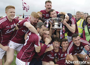 The joy of winning:  Galway players with the cup after winning the Connacht Senior Football Championship final against Roscommon at Dr Hyde Park on Sunday. 