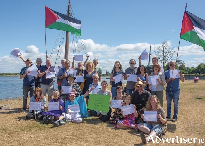 Members of the Kinvara community holding the petition signed by more than 230 people in the village, calling for support for the Occupied Territories Bill. Photo:- Ger Ryan Photography