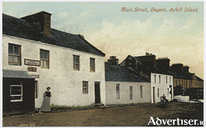 Main Street, Achill Mission Colony, Dugort, showing a feature of the development in its alternating single and two storey buildings (Mayo County Library).