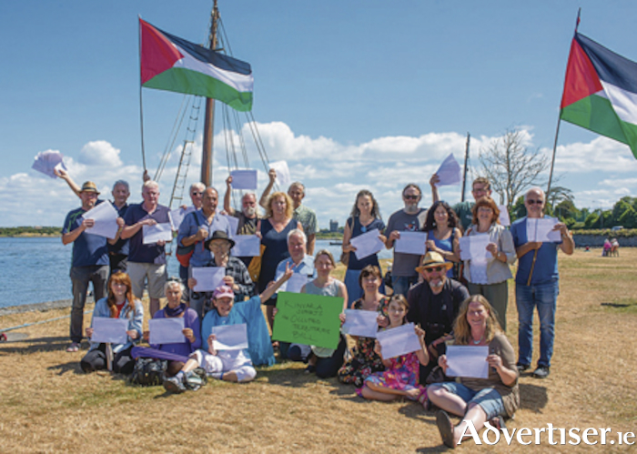 Members of the Kinvara community holding the petition signed by more than  two hundred and thirty people in the village, calling for support for the Occupied Territories Bill. Photo:- Ger Ryan Photography
