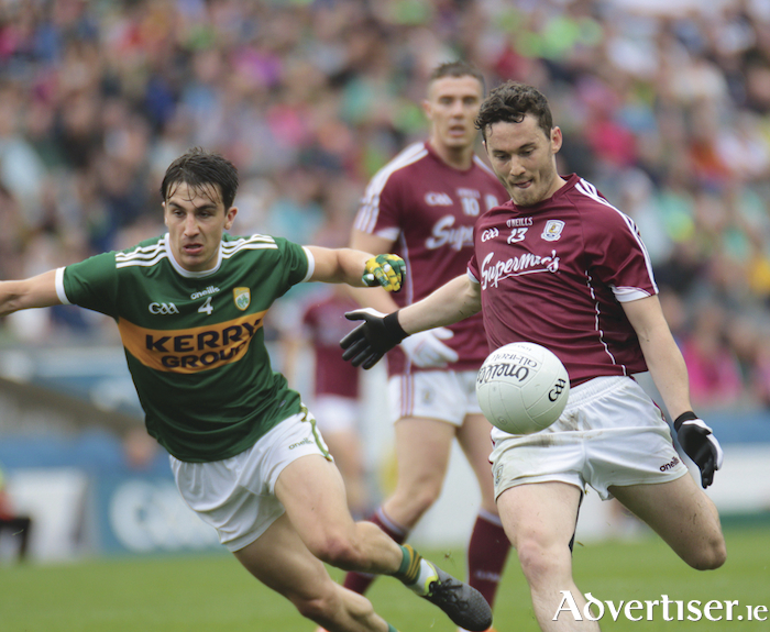 Galway corner forward Ian Burke and Kerry's Brian Ó Beaglaoích in action from the Super 8 game at Croke Park on Sunday. Photo:-Mike Shaughnessy