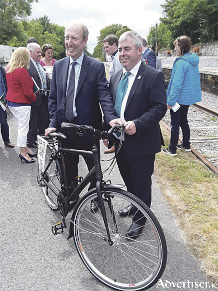 Minister Kevin 'Boxer' Moran TD and Minister Shane Ross TD, at the Greenways Strategy launch on the Old Rail Trail in Moate.