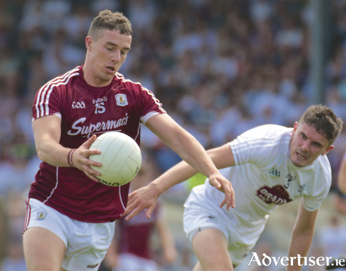 Galway forward Eamonn Branningan and Kildare's David Hyland in action from the GAA Super 8 game at St Conleth's Park, Newbridge, Co Kildare, Sunday. 