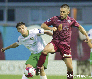 Galway United player / manager Alan Murphy puts Cabinteely's Zach O'Neill under pressure during United's 3-2 victory at Eamonn Deacy Park on Friday night. Photo:-Mike Shaughnessy