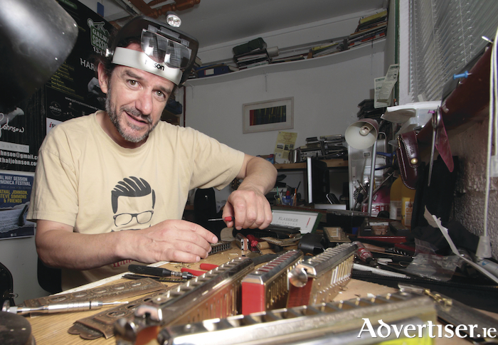 Cathal Johnson, harmonica player, in his workshop where he repairs the instruments. Photo: Mike Shaughnessy.