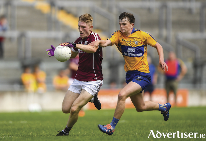 Galway captain Conor Raftery in action against Conor Carrig of Clare during the Electric Ireland GAA Football All-Ireland Minor Championship quarter-final against Clare in Tullamore, Co Offaly. Photo by Harry Murphy/Sportsfile