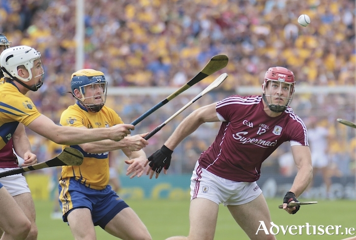 Galway's Jonathan Glynn is chased by Clare's Séadna Morey and Conor Cleary in the All Ireland Senior Hurling Championship semi-final at Simple Stadium on Sunday. Photo:-Mike Shaughnessy