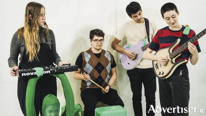 Frankie Cosmos (on the right) and her band.